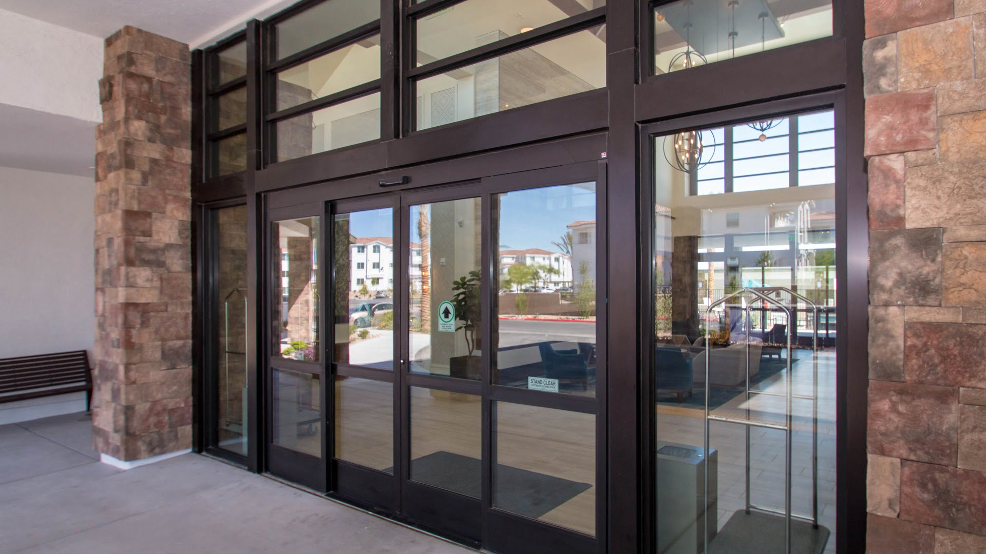 Brown aluminum commercial windows near hotel entry